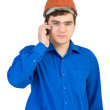 Royalty-Free Stock Photo: Man in a helmet speaks on the phone