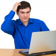 Young man comb head siting for laptop — Stock Photo