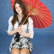 Beautiful girl sits with the Japanese umbrella — Stock Photo #2292349