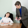 Stock Photo: Tutor and schoolgirl