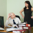 Boss and the secretary on a workplace — Stock Photo