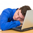 Young man sleeps with the laptop — Stock Photo