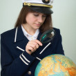 Royalty-Free Stock Photo: Sea captain looks at the globe