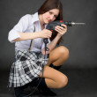 Young woman with an electric drill - Stock Photo