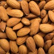 Cleared golden almonds background — Stock Photo
