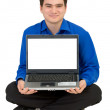 Guy sits on a floor with the laptop — Stock Photo