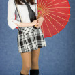Stock Photo: Young woman with the Japanese umbrella in a hand