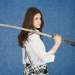 Young woman with the Japanese sword in a hand — Stock Photo