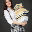 Stock Photo: Schoolgirl with big pile of books