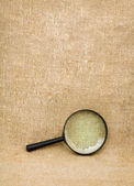 Magnifying glass on the sacking — 图库照片