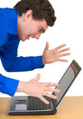 Young man and laptop — Stock Photo