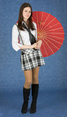 Beautiful girl stand with the Japanese umbrella — Stock Photo