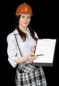 Beautiful girl in a helmet with tablet and penci — Stock Photo