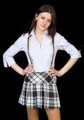 Beauty in a white shirt and skirt on black — Stock Photo