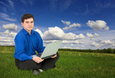 Young businessman work with laptop — Stock Photo