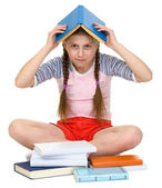 Young girl with book on head — Stock Photo