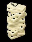 Tornet från domino ben på en svart — Stockfoto
