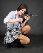 Young woman with an electric drill — Stock Photo