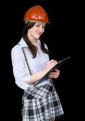 Girl in a helmet with a tablet in hands — Stock Photo