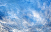 Plumose clouds in the dark blue sky — Stock Photo