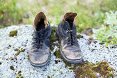 Old leather brown dirty boots — Stock Photo