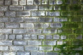 Brick gray old weathered wall — Stock Photo