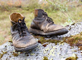 Old torn leather boots — Stock Photo