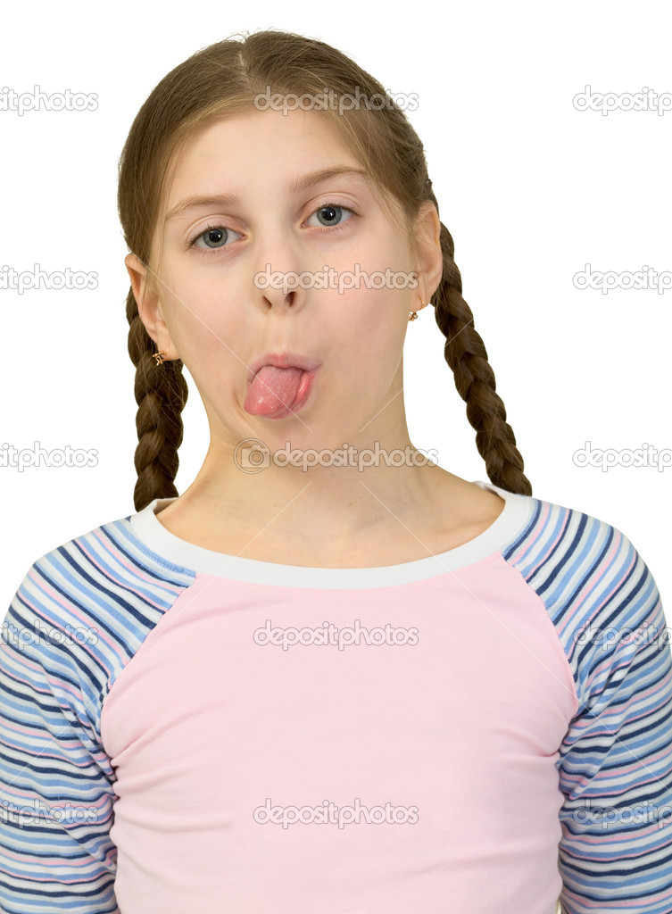 Young girl to put out one's tongue - Stock Image