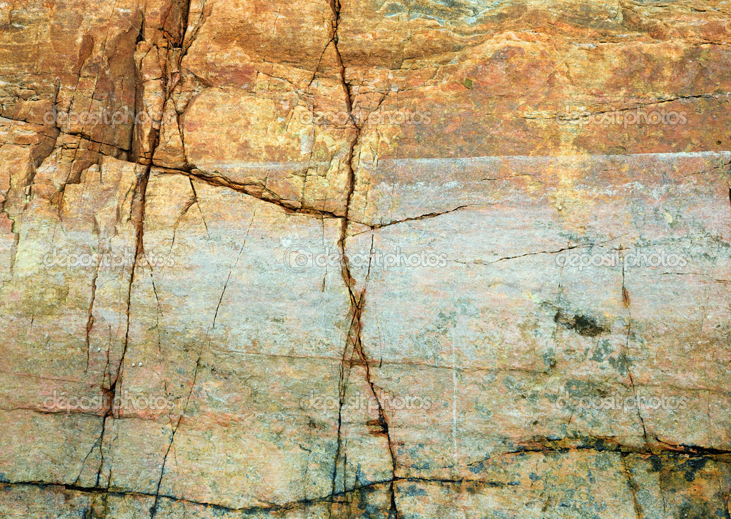 The cracked yellow rock on seacoast backdrop — Stock Photo #2295393