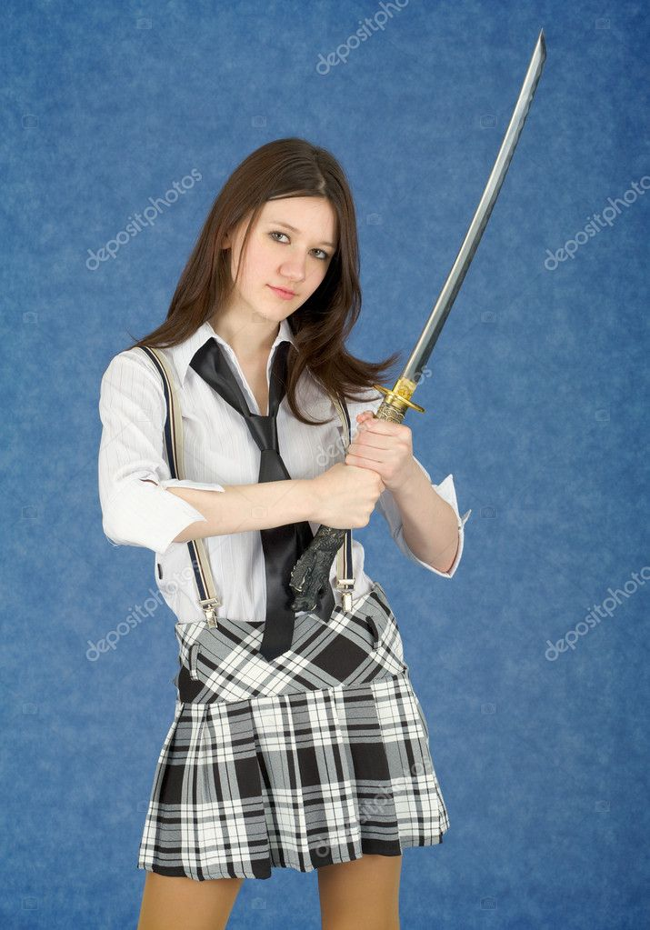 Portrait of the young woman with the Japanese sword in a hands — Stock Photo #2299521