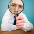 Funny with a magnifier — Stock Photo