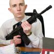 Accountant with a rifle in hands — Stock Photo