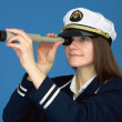 Portrait of the woman - captain with telescope — Stock Photo