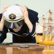 Depressed girl in a sea uniform — Stock Photo #2301105
