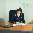 Beauty in a uniform of captain examines geograph — Stock Photo #2301181