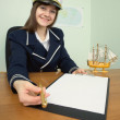 Woman - captain suggests us to sign document — Stock Photo #2301192