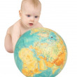 Baby with geographical globe isolated on white — Stock Photo