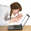 Stock Photo: Girl emotionally shouts at laptop