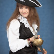 Beautiful girl - pirate on blue background — Stock Photo