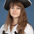 Portrait of pirate girl in black hat — Stock Photo