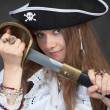 Royalty-Free Stock Photo: Girl in pirate hat with a sabre in hands