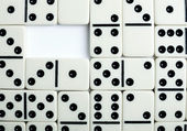 Dominoes background with hole — Stock Photo