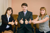 Team of businessmen show thumb up — Stock Photo