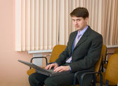 Person in a suit with the laptop — Stock Photo