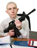 Accountant with a rifle in hands — Stockfoto