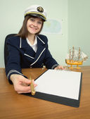 Woman - captain suggests us to sign document — Stock Photo