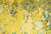 Vecchio danneggiato la vernice su un muro di cemento — Foto Stock