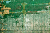Green surface of wall covered with board — Stock Photo