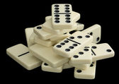 Heap of dominoes on a black background — Stock Photo