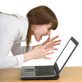 Girl emotionally shouts at the laptop — Stock Photo